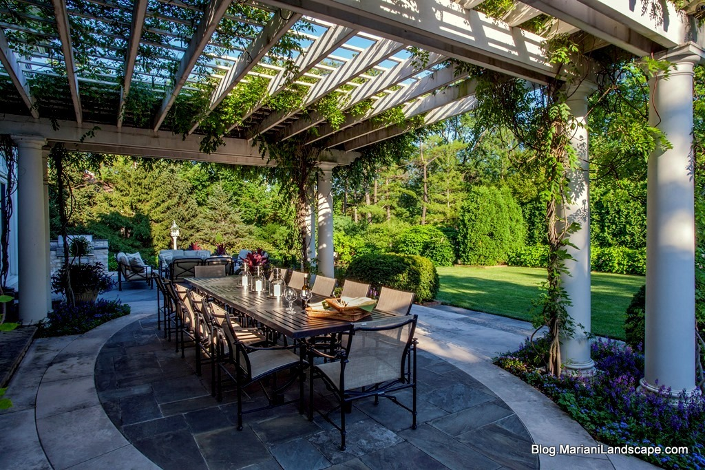 Dining Under A Pergola In The Garden With Mariani Landscape