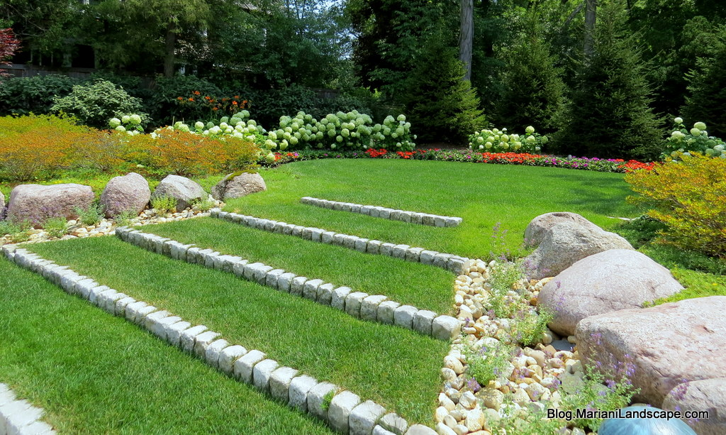 Formal lawns and woodland gardens in the garden with for Formally designed lawn